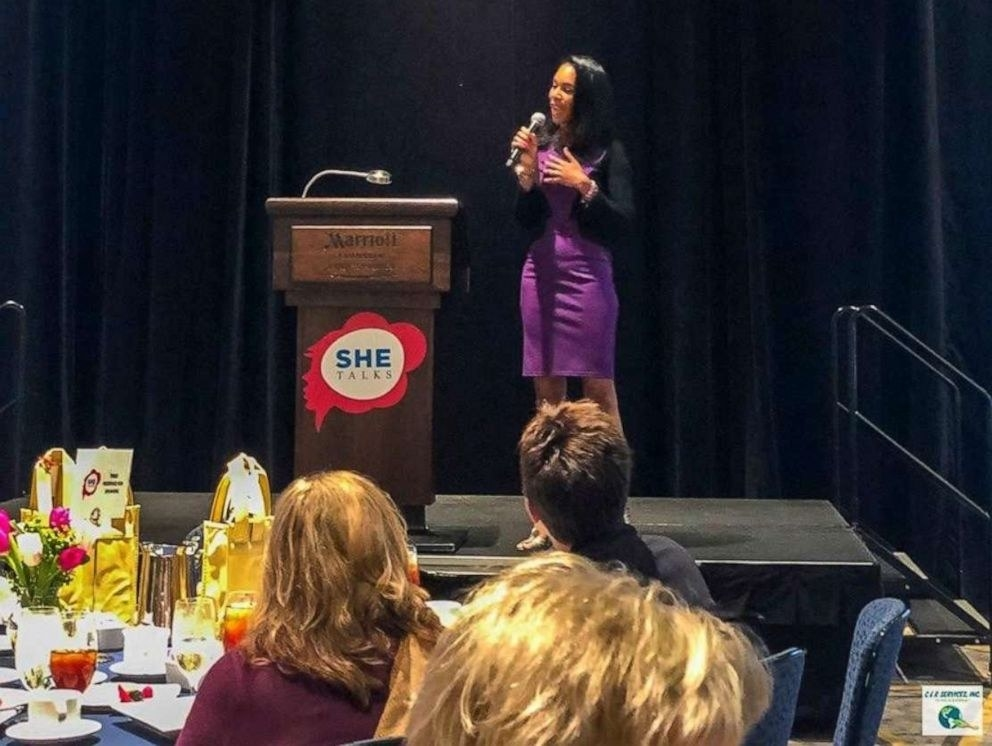 Lakisha Simmons delivering a keynote at a women's conference.