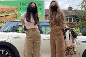 two models wearing two different shades of the brown corduroy pants