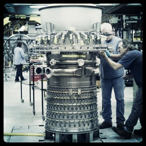 Technicians Lee Rertel and Darrell Miller at work on an LM6000 gas turbine, whose technology is d...