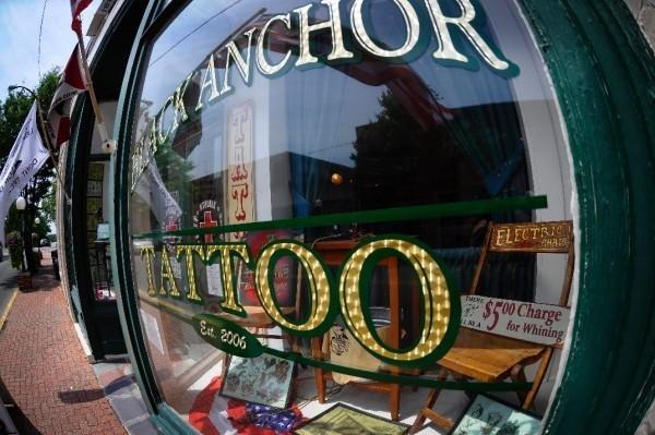 7. Black Anchor Tattoo