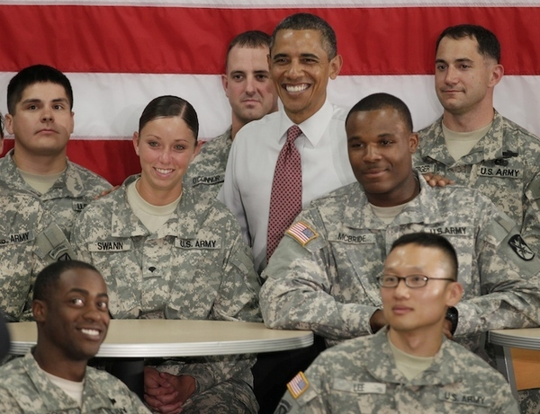 President Barack Obama is photographed with soldiers from the 10th Mountain Division, many of who...