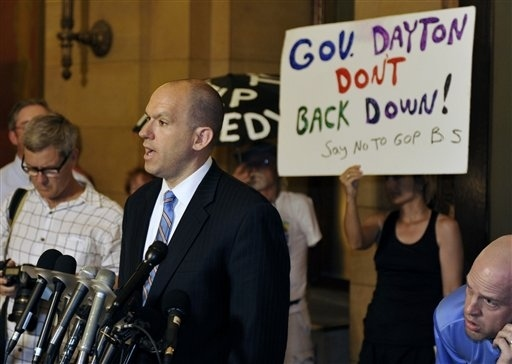 Michael Brodkorb, Senate Republican spokesman, gives an update to reporters outside the governor&...