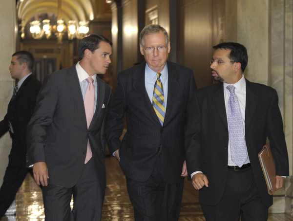 Senate Minority Leader Mitch McConnell of Ky., center, heads out of the Capitol for a meeting at ...