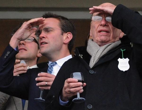 James Murdoch, left, and Rupert Murdoch, right, during the Cheltenham Festival at Cheltenham, Eng...