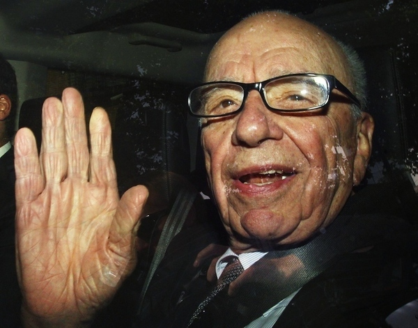 Rupert Murdoch is driven away from News International headquarters in Wapping, east London, Frida...