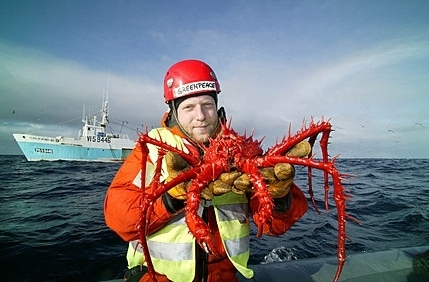 He's holding a giant crab