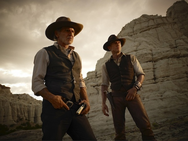 In this publicity image released by Universal Pictures, Harrison Ford, left, and Daniel Craig are...