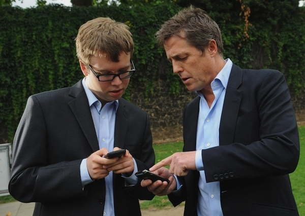 British actor Hugh Grant, right, speaks with an unidentified 'Hacked Off' campaigner outs...