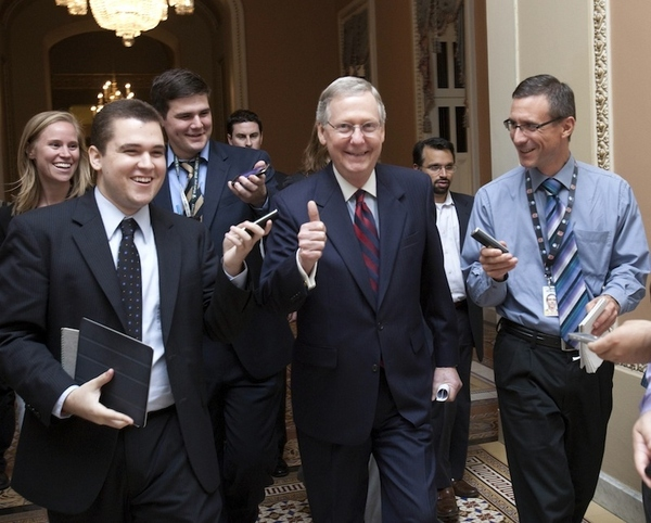 Senate Minority Leader Mitch McConnell, R-Ky., is all smiles as he walks to the Senate floor to a...