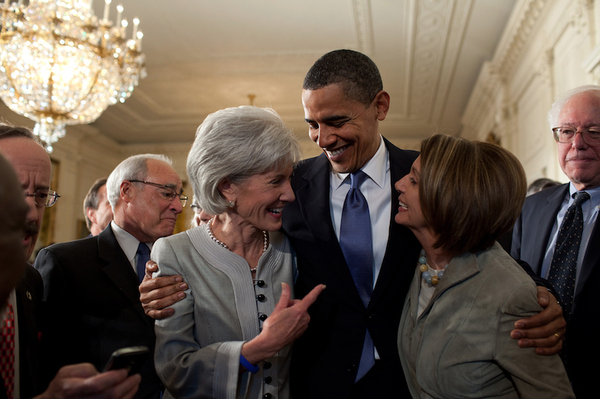 President Barack Obama Embraces Kathleen Sebelius and Nancy Pelosi After Signing the Health Insur...
