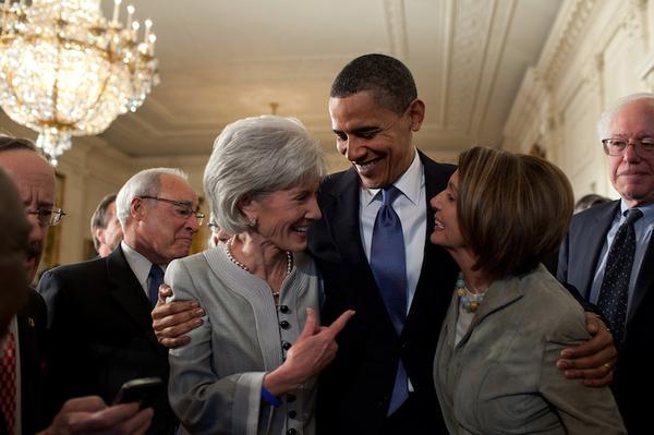 President Barack Obama Embraces Kathleen Sebelius and Nancy Pelosi After Signing the Health Insur...