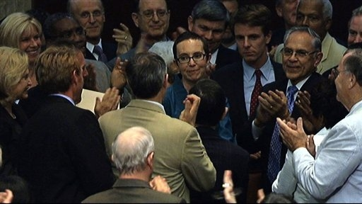 In this image from House Television, Rep. Gabrielle Giffords, D-Ariz., center, appears on the flo...