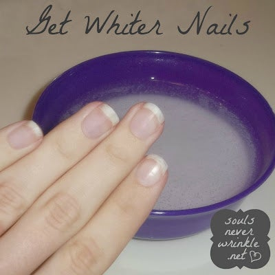 Soak your nails in a solution of hot water, hydrogen peroxide, and baking soda for about a minute. Or you could also put some whitening toothpaste on a toothbrush and scrub the stains off your nail.