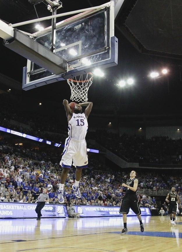 Prudue's Anthony Johnson (1) looks on as Kansas' Elijah Johnson dunks in their NCAA tournament third-round college basketball game at CenturyLink Center in Omaha, Neb., Sunday, March 18, 2012. Kansas won 63-60.