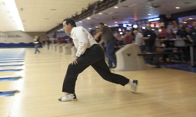Republican Presidential candidate Rick Santorum bowls in Wisconsin. (Reuters Pictures)