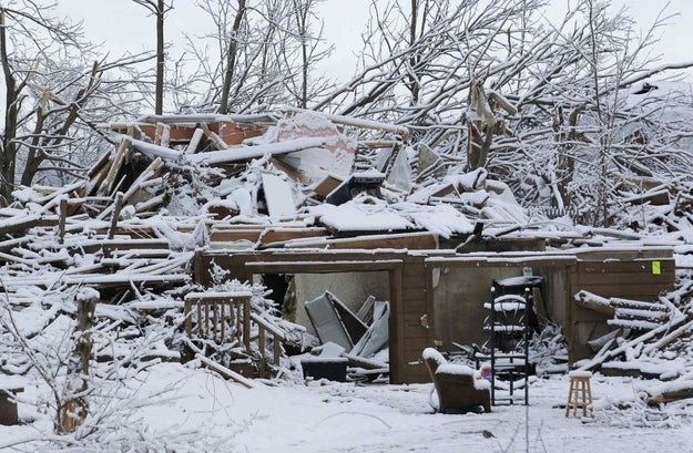 Snow covers a storm-damaged home in Henryville, Indiana, March 5, 2012. Calm weather gave dazed residents of storm-wracked U.S. towns a respite on Sunday as they dug out from a chain of tornadoes that cut a swath of destruction from the Midwest to the Gulf of Mexico, killing at least 39 people.