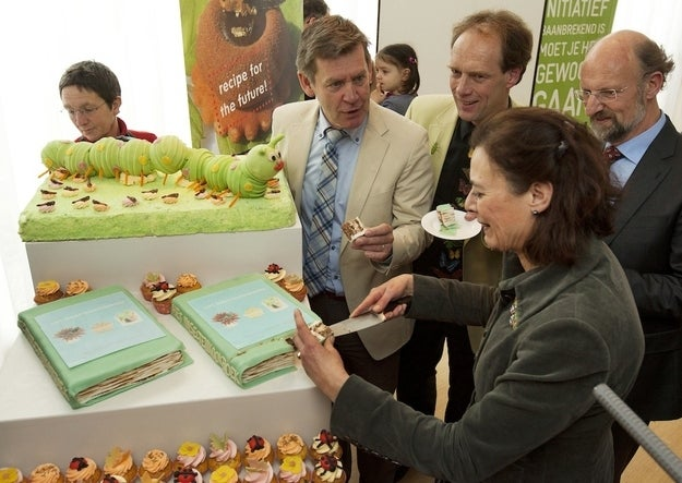 """Professor Louise Fresco (2nd R) and authors of """"The Insect Cookbook"""" Henk van Gurp (C), Marcel Dicke (3rd R) and Arnold van Huis (R), eat a piece of cake made of insects at the University of Wageningen April 17, 2012."""