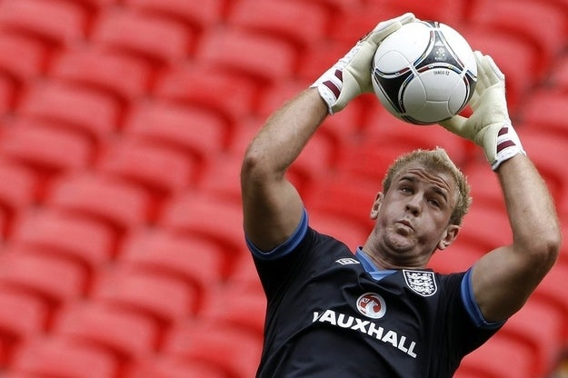 England's goalkeeper Joe Hart catches a ball during a team training session at Wembley Stadium in London.