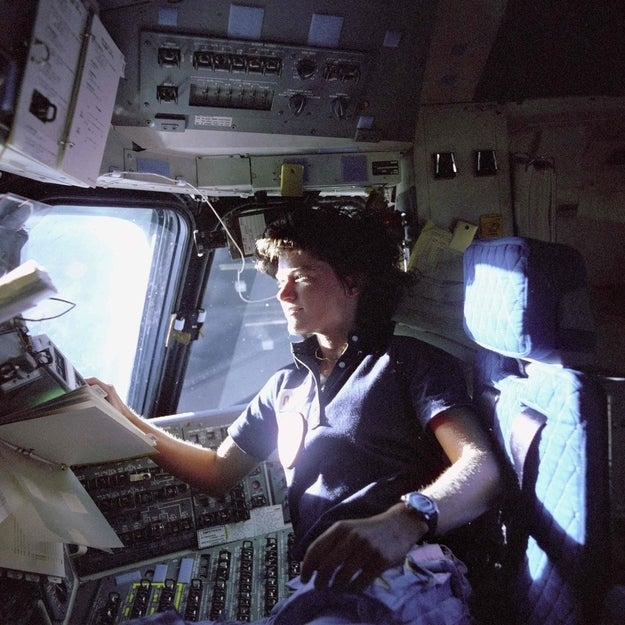 Astronaut Sally Ride, mission specialist on STS-7, monitors control panels from the pilot's chair on the Flight Deck of the Space Shuttle Challenger in this NASA handout photo dated June 25, 1983. Floating in front of her is a flight procedures notebook.