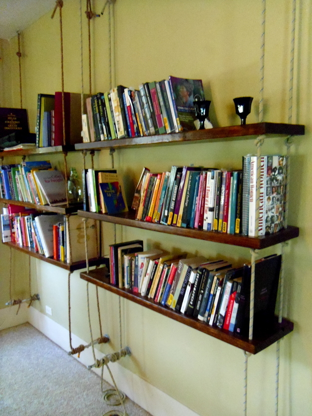 larger more industrial hanging rope bookshelves with