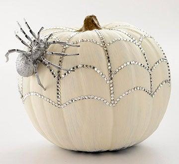Glue rhinestones on to create a faux spider web.