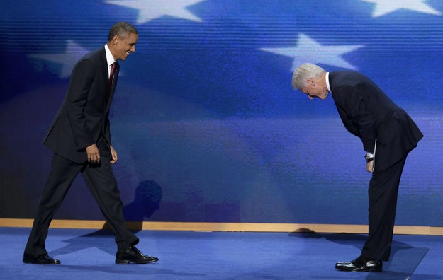 Former President Bill Clinton bows as President Barack Obama walks on stage after Clinton's address to the Democratic National Convention.