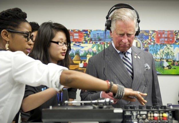 Prince Charles learns how to scratch and fade with a turntable as he tours an employment skills workshop in Toronto May 22, 2012. The royal couple is on a four-day visit to Canada to mark the Queen's Diamond Jubilee.