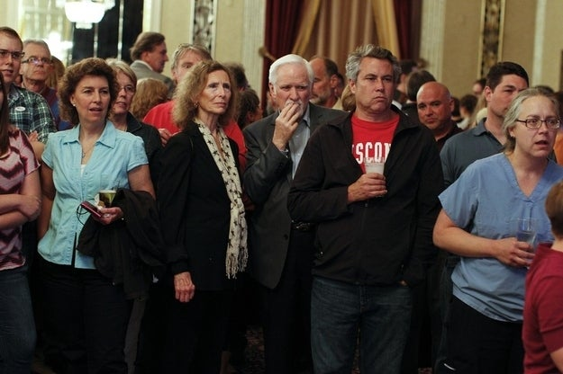 Barrett supporters watch early election returns.