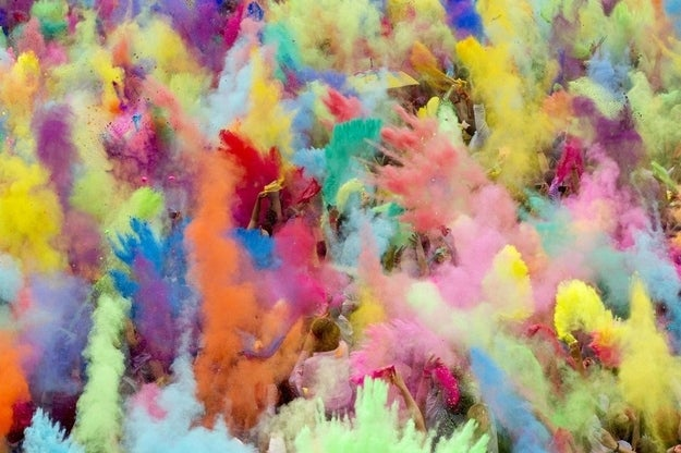 People throw coloured powder in the air during Holi festival celebrations in Berlin, July 29, 2012. Holi, also known as the festival of colours, is a festival celebrated in India and other Hindu countries that in its original form heralds the beginning of spring. The Berlin event brought Indian Djs, acrobatics and dance to the German capital.