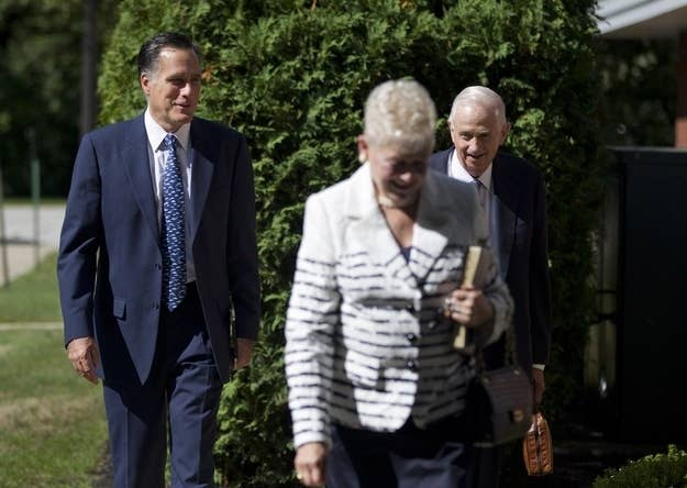 Mitt Romney enters a church service at the Church of Jesus Christ of Latter-day Saints in Wolfeboro, N.H.