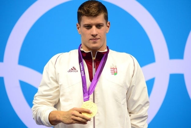 Hungary's gold medalist Daniel Gyurta poses on the podium after the men's 200m breaststroke final.