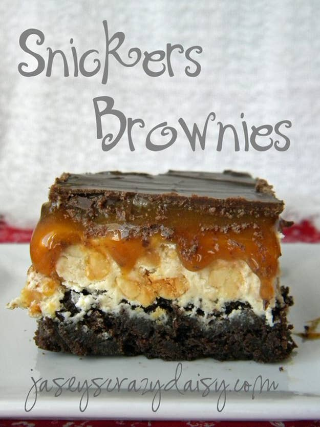Ingredients:Brownie Layer- 1 box of brownie mix- 1/4 cup hot fudge topping, unheatedNougat Layer - 1/4 cup unsalted butter- 1 cup granulated sugar- 1/4 cup evaporated milk- 2 (7 oz.) jars marshmallow creme- 1/4 cup peanut butter- 1 1/2 cups salted peanuts, roughly chopped- 1 teaspoon vanillaCaramel Layer- 1 (17 oz.) jar of caramelCandy Bar Topping- 1 1/4 cups chocolate chips- 1/4 cup peanut butterDirections:- Prepare brownie batter according to package directions for a 9x13-inch pan - Add hot fudge ice cream topping to the batter Make sure to follow the high - Cook according to package directions- Cool completely- Melt butter in a saucepan over medium heat. - Add sugar and milk, stirring until dissolved. - Bring to a boil. - Add in the marshmallow creme, peanut butter, and vanilla stirring until smooth. - Turn off heat and fold in peanuts. - Pour evenly over cooled brownies, using a spatula to spread - Cool completely- Scoop caramel topping into a heavy bottomed saucepan and heat over low until caramel is soft and easy to stir- Pour the caramel over the nougat layer evenly Make sure to pour it evenly across the nougat covering as much as the surface as you can. This makes it easier to spread the caramel with a spatula- Cool completely- Melt chocolate chips and peanut butter together in a saucepan over low heat, stirring occasionally, until smooth- Pour over nougat layer - Cool in fridge until ready to serve