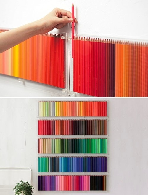 Organize art supplies into a rainbow display.