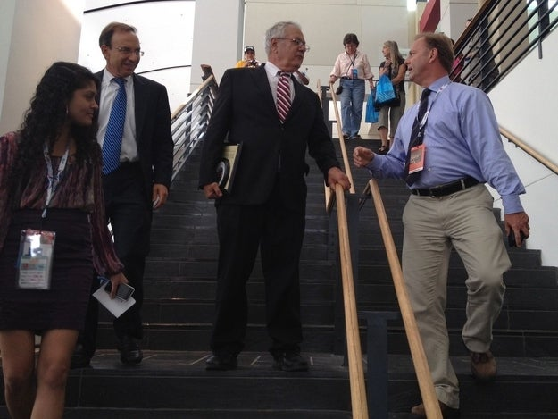 Rep. Barney Frank, center, speaks to a reporter after addressing the LGBT Caucus at the Democratic National Convention.