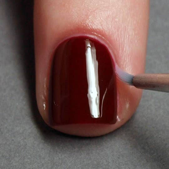 27 nail hacks for the perfect diy manicure erase mistakes by dipping a tiny brush into nail polish remover solutioingenieria Images