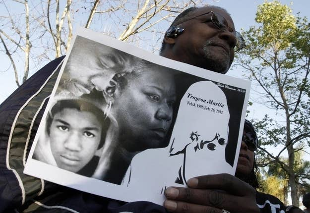 Freddie Muse holds a sign at a rally to call for justice in the murder of Trayvon Martin at Leimert Park in Los Angeles, March 22, 2012.