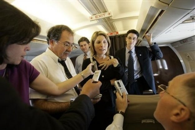 Wallace answers reporters' questions aboard the McCain plane in 2008.