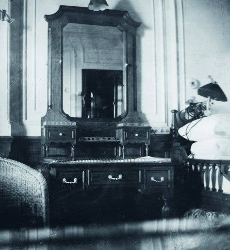 The bedroom in the Browne suite aboard the Titanic, which would have been elegant in any location.
