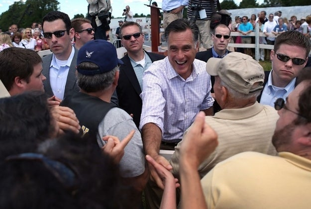 Romney greets people during a campaign event at Scamman Farm in Stratham, N.H.