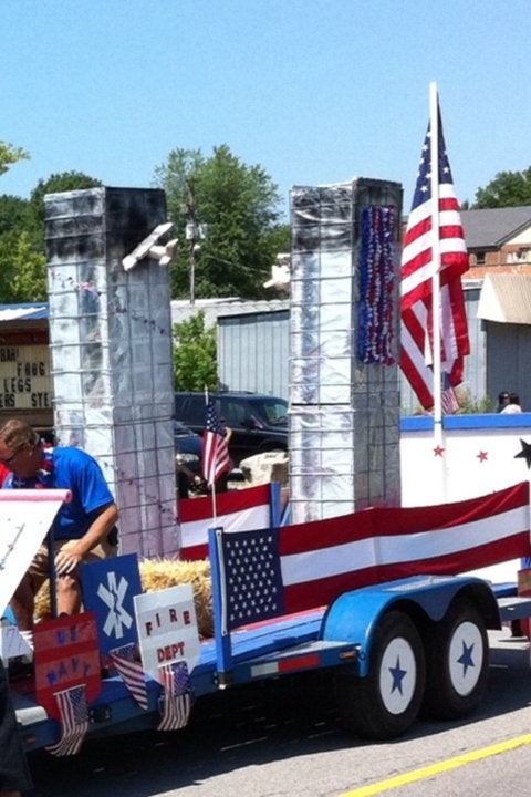 From last year, town not named. And yes, it was a 4th of July parade, not a 9/11 ten-year anniversary parade. Via reddit. Why is the South Tower charred pre-crash? And how bout some jumping people? HISTORICAL ACCURACY, please.