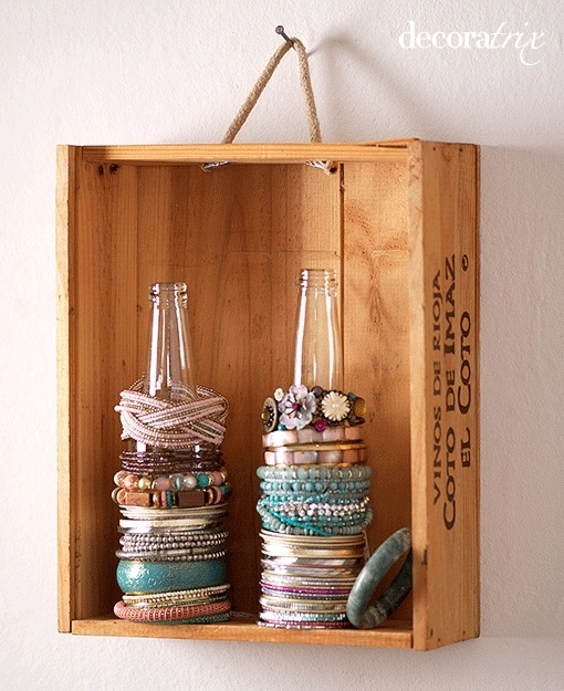 Use Glass Bottles to Store Bracelets and Ponytail Holders