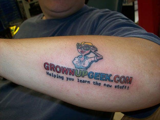 One of Joe Tamargo's early forearm tattoos. Grownupgeek.com still exists.
