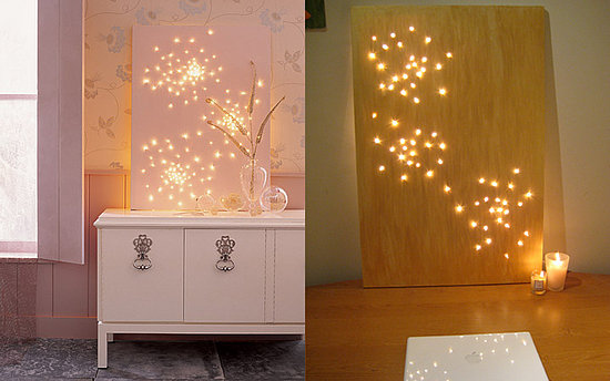 Create constellation art with string lights and a canvas.