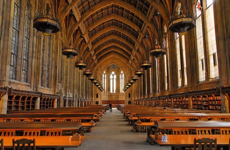 Completed in 1926 in Collegiate Gothic style, the University of Washington's Suzzallo LIbrary contains an incredible 250-foot long, 52-foot wide Graduate Reading Room featuring a timber-vaulted ceiling, leaded windows and cast-stone ashlar wall blocks.