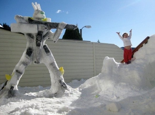 Last year Miguel Valenzuela had a shot of his daughter taking on a fearsome Valkyrie VF-1S Robotech snow robot. Here we see her about to execute a back-flip into a series of furious and deadly karate moves.