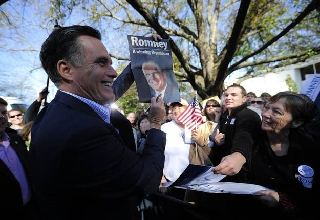 Romney posed with a campaign poster of his father's last week in South Carolina.