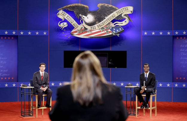 Stand-ins for Romney, left, and Obama run through a rehearsal with moderator Candy Crowley at Hofstra University in Hempstead, N.Y.