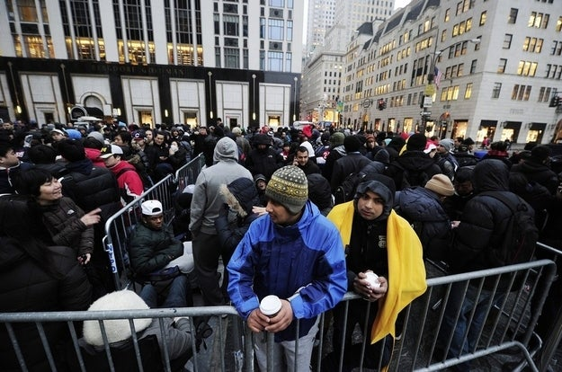 People wait in line to enter Apple's flagship store on Fifth Avenue to be amongst the first one to buy the new iPad, in New York, on March 16, 2012.