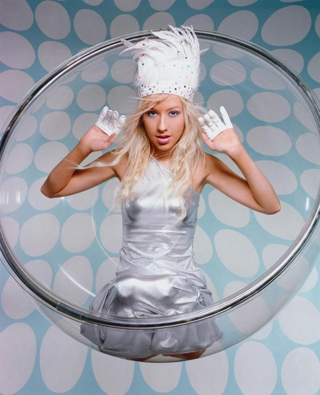 """Photographer: """"Christina, honey: when I look at you I immediately think Futuristic Indian Princess. Now get in that half of a glass bowl and pretend you're a kitty-cat."""""""