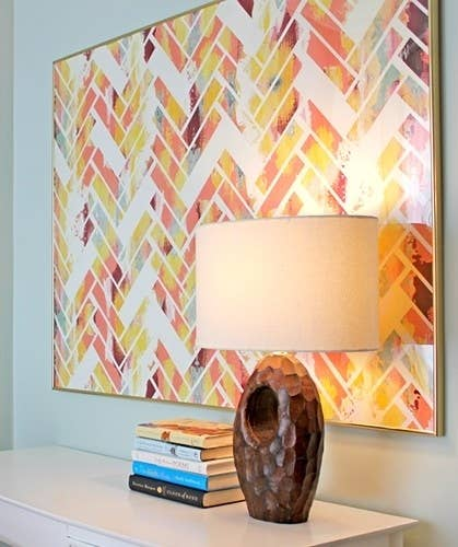 39 easy diy ways to create art for your walls paint a crazy colorful random design on a canvas use tape to make a herringbone solutioingenieria Images